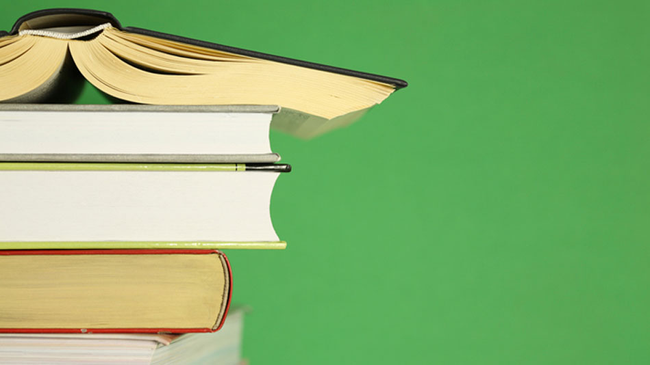 A stack of books against a green background