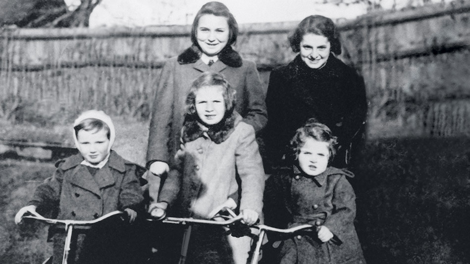 Clockwise from lower right, the author at age 7 with her cousin Alena, Aunt Ola, and mother, Anna Spieglova Korbel.