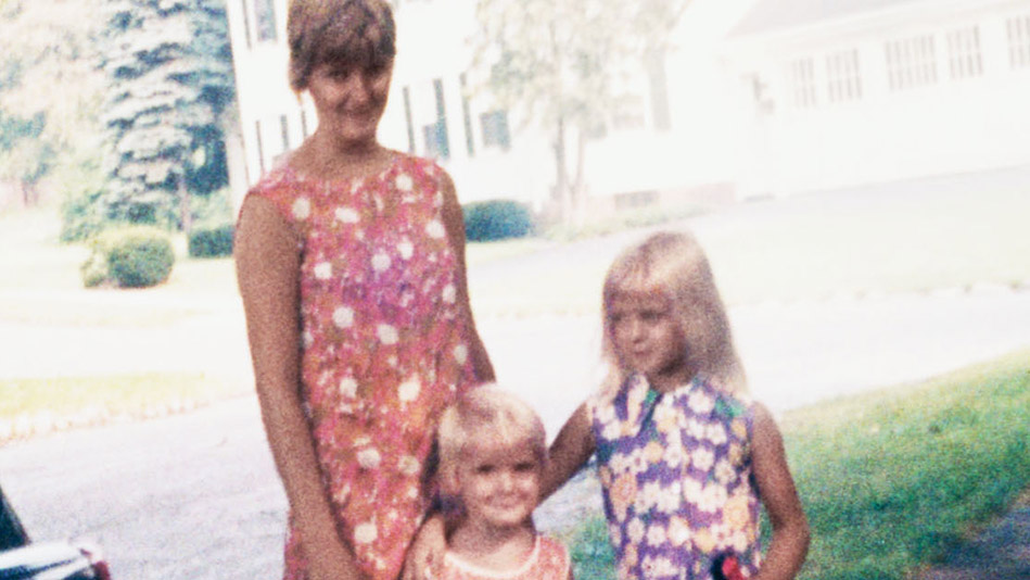 Elizabeth (center) with her sister and mom in the early 70s.