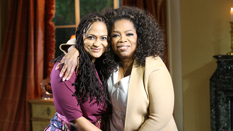 Oprah Winfrey and Ava Duvernay smiling for the camera.