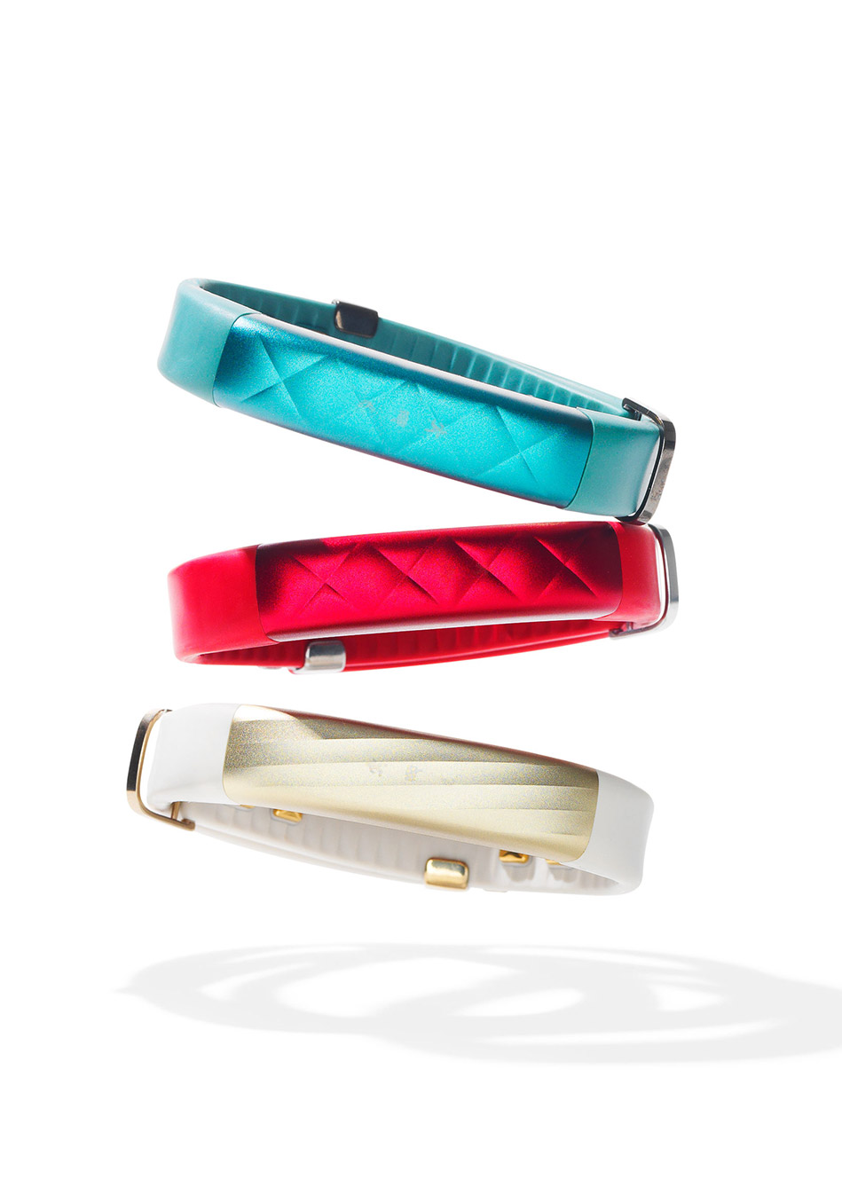 Jawbone UP3 in Teal Cross, Ruby Cross, and Sand Twist