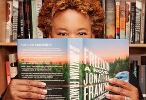 Oprah's Book Club producer Jill reading Freedom by Jonathan Franzen