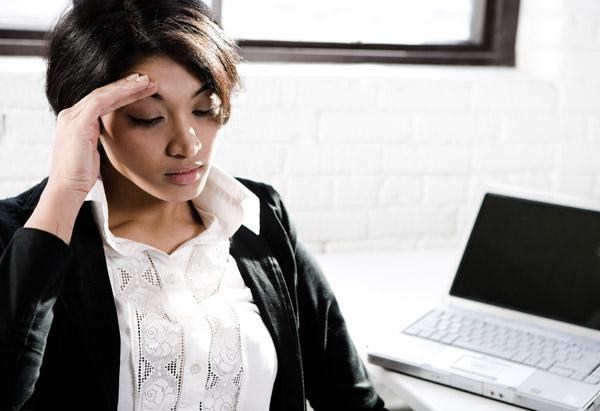 frowning woman at computer