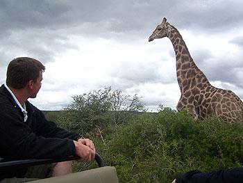 Security guard Jonathan gets close to a giraffe