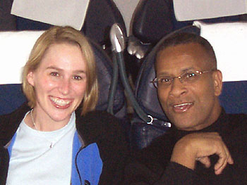 Carri and friend on the plane to South Africa.