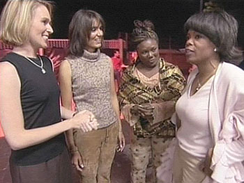 Carri, Marina, Tiffany and Oprah greet each other before the concert starts.