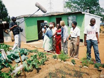 A woman in Motsoaledi South Africa tends her garden