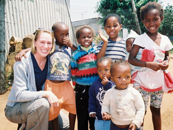 Carri poses with some of the children from the Jembizweni Daycare Center