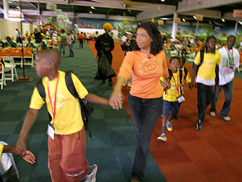 Oprah greets the children arriving for the carnival.