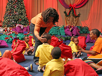 Oprah helps hand out gifts.