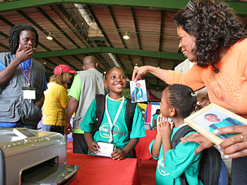 Oprah and children admire the new digital photos.