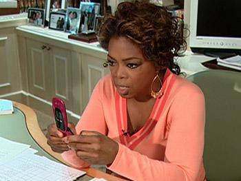 Oprah sends the contestants a text message.