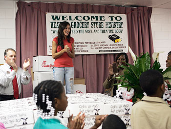 'Oprah's Big Give' contestant Brandi presents Heaven's Grocery with food supplies.