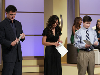 Stephen, Brandi and Cameron open their envelopes.