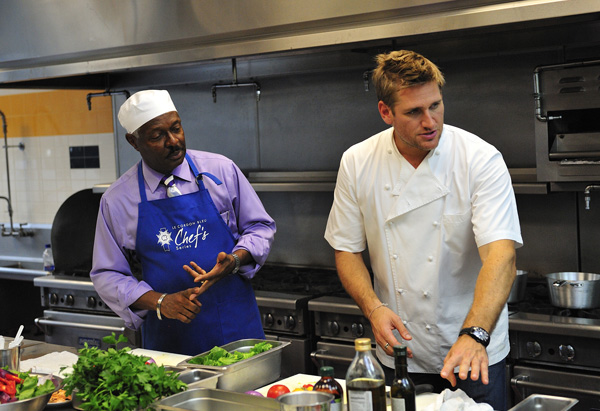 Curtis Stone helps Tony in the kitchen