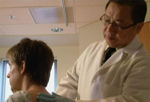 Doctor examines Matt's back