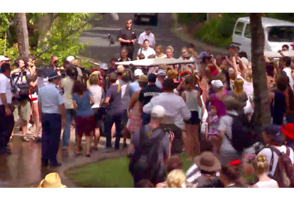 Oprah and Gayle drive through the crowds