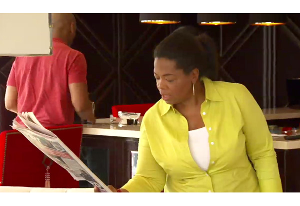 Oprah reads the newspaper