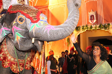 Oprah Winfrey with painted elephant at City Palace in Jaipur