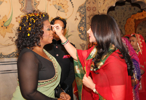 Princess Diya Kumari greets Oprah Winfrey inside the spectacular palace