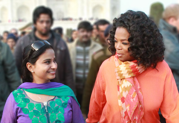 Oprah Winfrey and her guide at the Taj Mahal