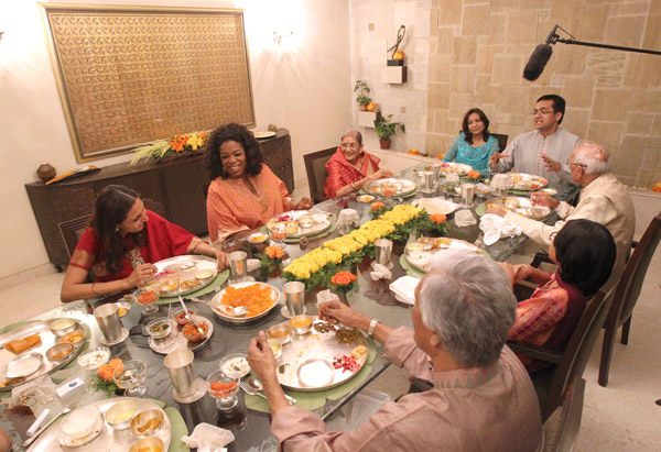 Oprah sits down for her first traditional Indian meal