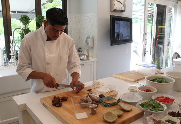 A chef prepares food for Oprah Winfrey and the Kardashians