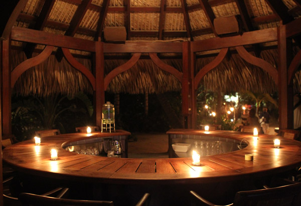 Poolside bar lit by candles on Musha Cay, David Copperfield's private island