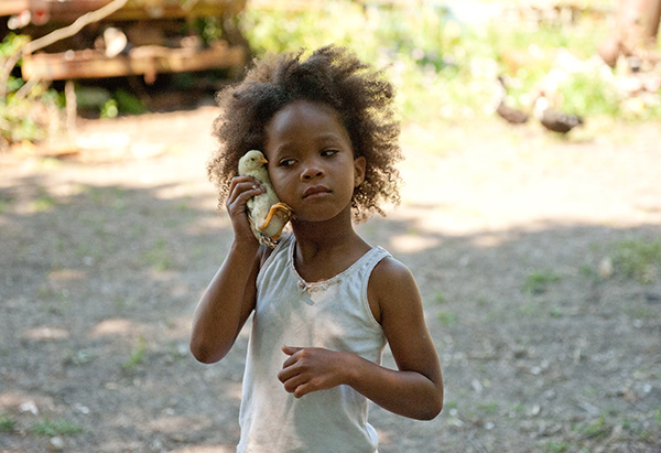 Quvenzhane Wallis holding up a chick in Beasts of the Southern Wild