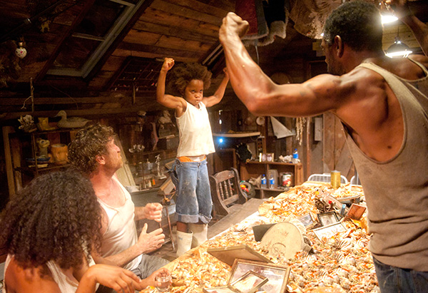 Dwight Henry and Quvenzhane Wallis flexing their arms in Beasts of the Southern Wild