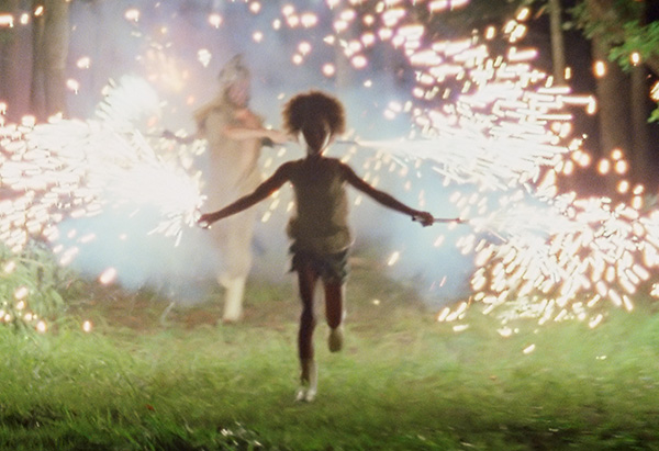 Quvenzhane Wallis running with sparklers in Beasts of the Southern Wild