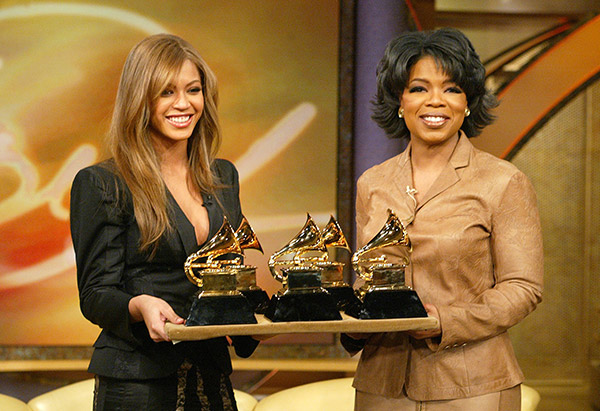 Oprah Winfrey and Beyonce hold Grammys