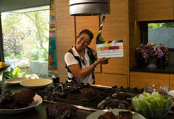 Kristen slates in the kitchen of John Legend and Chrissy Teigen