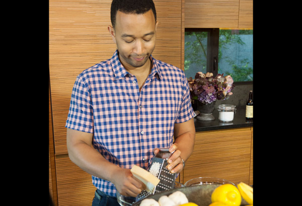 John Legend grating cheese