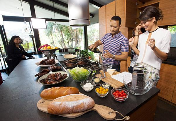 John Legend and Chrissy Teigen in the kitchen