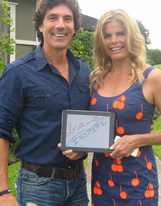 "Bobby Williams and Mariel Hemingway holding up ""Love/Inspire"" sign"