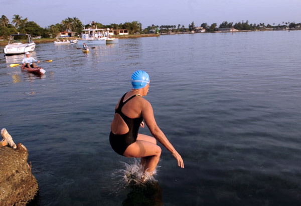 Diana Nyad jumps into the water at Ernest Hemingway Nautical Club in Havana