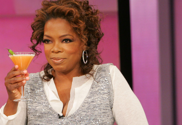 Oprah toasting