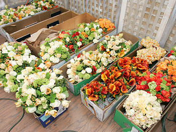 Hundreds of flowers for table centerpieces are delivered.