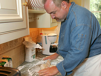 Chef Art Smith prepares biscuits.