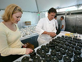 Chefs prepare individual soup tureens.