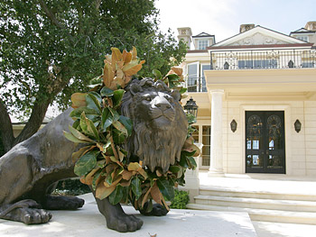 A lion statue welcomes guests to Promised Land.