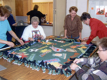 Volunteers make blankets in Sumner, Iowa.