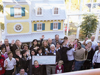 Felicia, Arline and Bob present their check to the Ronald McDonald House.