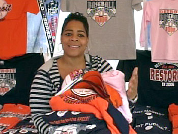 Sheril Hurt shows off sportswear donated to the homeless.