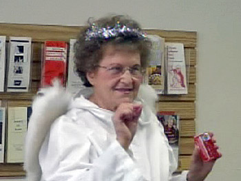 Phyllis Mroczek dresses as one of 'Oprah's Angels' to help the elderly.