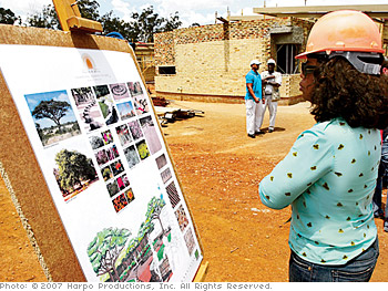 Oprah tours the leadership academy during construction.