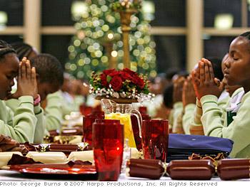 The girls enjoy the Christmas dinner.