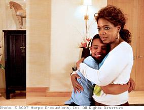 Oprah hugs Charlene.