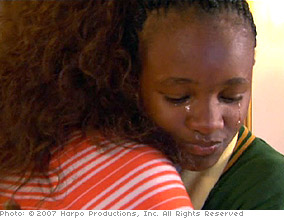 Oprah comforts a brave girl in South Africa.